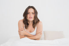 Sleepy woman sitting in bed Royalty Free Stock Image