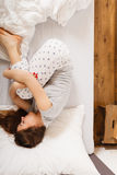 Sleepy woman sleeping in the bed. Royalty Free Stock Photo