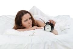 Sleepy woman turns off the alarm Stock Photos