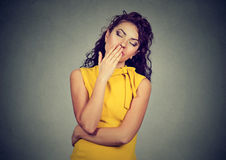 Sleepy woman with wide open mouth yawning eyes closed looking bored Royalty Free Stock Photo