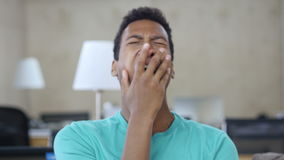 Sleepy Yawing Black Young Man in Office, Portrait stock video footage
