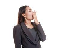 Sleepy young Asian woman yawn. Royalty Free Stock Photos