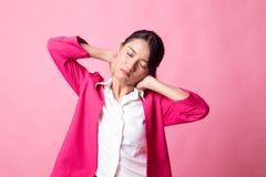 Sleepy young Asian woman yawn stock photography