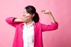 Sleepy young Asian woman yawn royalty free stock photo