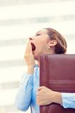 Sleepy young business woman, running to work wide open mouth yawning. Its is too early for this meeting. Closeup portrait sleepy young business woman, running to Stock Image
