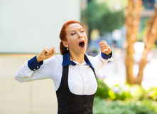 Sleepy young business woman with wide open mouth yawning Royalty Free Stock Photography