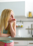 Sleepy young woman in kitchen Royalty Free Stock Photography