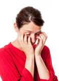 Sleepy young woman scratching her eyes for allergies. Fatigue and apathy - portrait of a sleepy young woman scratching her eyes for allergies, standing with eyes Stock Image