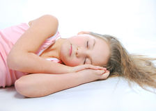 Sleepyhead. The sleeping girl on a white background Stock Photo