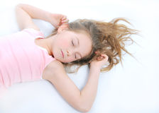 Sleepyhead. The sleeping girl on a white background Royalty Free Stock Image