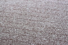 Sleet Frozen Rain. Icy Sleet and frozen rain on Wooden deck Surface in winter Royalty Free Stock Photo