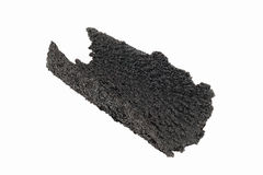 Sleeve of Creosote removed from Stovepipe. Dangerous accumulation of Creosote removed from a Wood Stove Chimney Pipe Stock Photography