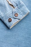 Sleeve of jean cardigan with two buttons Royalty Free Stock Photo
