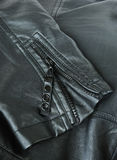 Sleeve of a leather jacket Stock Images