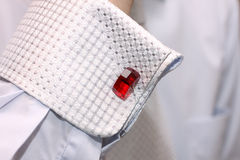 Sleeve Of A White Shirt With A Red Cuff Link Royalty Free Stock Photography