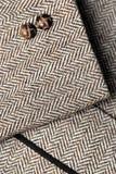 Sleeve of tweed brown jacket royalty free stock photography