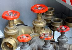 Sleeve valves and fire lances of trucks of firefighters Stock Photo