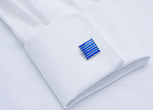 Sleeve of a white shirt with cuff link Stock Image