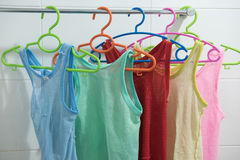 Sleeveless children`s shirt. Many colors sleeveless children`s shirt on a hanger Stock Photography