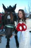 Sleigh Bride. Bride standing next to a horse royalty free stock photos