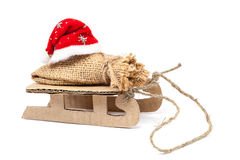 Sleigh con un sacco e un cappello di Santa Claus Fotografia Stock