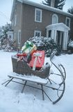 Sleigh filled with Christmas gifts on a snowy day Royalty Free Stock Photos