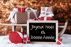 Sleigh With Gifts, Snow, Bokeh, Bonne Annee Means New Year Stock Photo