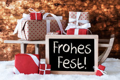 Sleigh With Gifts, Snow, Bokeh, Frohes Fest Means Merry Christmas Royalty Free Stock Photos