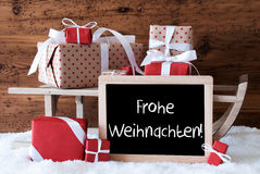 Sleigh With Gifts On Snow, Frohe Weihnachten Means Merry Christmas Royalty Free Stock Photo