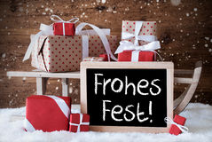 Sleigh With Gifts, Snow, Snowflakes, Frohes Fest Means Merry Christmas Royalty Free Stock Photos