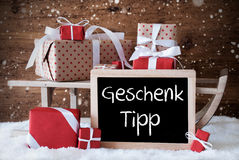Sleigh With Gifts, Snow, Snowflakes, Geschenk Tipp Means Gift Tip Stock Images