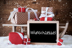 Sleigh With Gifts, Snow, Snowflakes, Wunschzettel Means Wish List. Chalkboard With German Text Wunschzettel Means Wish List. Sled With Christmas And Winter Stock Images