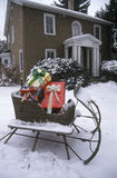 Sleigh With Presents on Lawn, St. Louis, Missouri Stock Photo