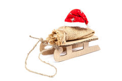 Sleigh with a sack and a Santa Claus hat. Royalty Free Stock Photography