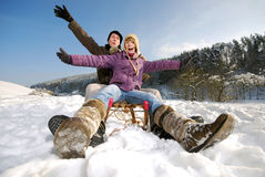Sleighing. Young couple is sleighing, has fun Royalty Free Stock Image