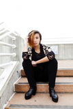 Slender Asian American Woman Sitting On Steps Royalty Free Stock Images