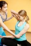 Slender athletes do stretching exercises Stock Photos