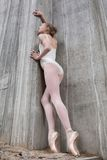Slender ballerina on a background of the concrete Royalty Free Stock Photography