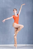 Slender ballerina rehearsing in a dance movement. On one foot on Royalty Free Stock Photography