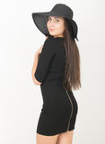 Slender beautiful Asian girl in little black dress and a black wide-brimmed hat Stock Photo