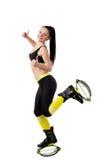 Slender brunette girl  in kangoo jumps shoes showing a fingers u Royalty Free Stock Images