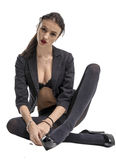 Slender brunette girl removes a business suit undressing Royalty Free Stock Photo