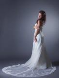 Slender brunette posing in stylish wedding dress Royalty Free Stock Photo