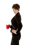 Slender businesswoman wit a cup of coffee Royalty Free Stock Photo
