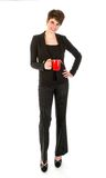 Slender businesswoman wit a cup of coffee Royalty Free Stock Image