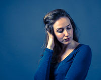 Slender Caucasian Female Somber Expression Stock Images