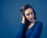 Slender Caucasian Female Somber Expression. Slender caucasian female with somber or gloomy expression Stock Images