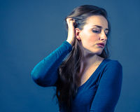 Slender Caucasian Female Somber Expression. Slender caucasian female with somber or gloomy expression Royalty Free Stock Image