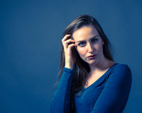 Slender Caucasian Female Somber Expression Stock Photography