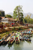 Boat in Inle lake. The slender, colorful boat is the typical transportation in Inle Lake, Myanmar royalty free stock photos
